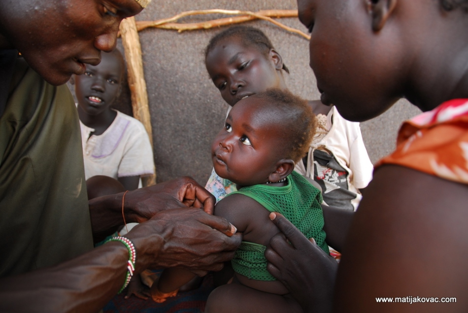 MUAC screening by a Nuer refugee, who is also a community health worker in Kakuma Refugee Camp (October 2010)